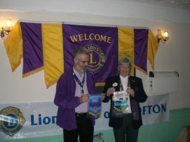 Lion President Harry exchanges Friendship Banners with DG Judith Goodchild