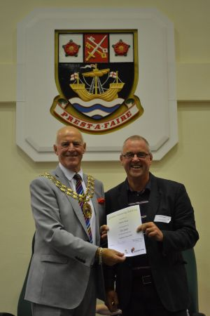 Charlie Read receiving his award from the Mayor