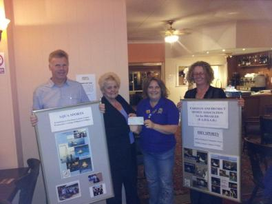 Lion President Vicky presenting the cheque to FADSAD accompanied by Ian & Jenny, owners of The Crofton
