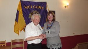 LION PRESIDENT REG NORTON HANDS OVER THE PRESIDENCY TO LION VP ALISON SALES
