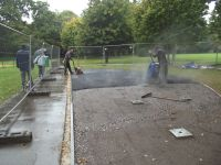 Work starts on the top layer...and so does the rain! Outdoor Gym 2 & 3 016