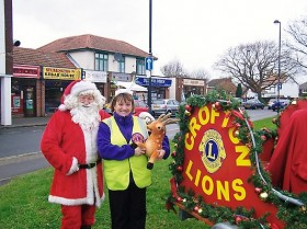 Santa and Lion President Lisa Pitt in 2008 Christmas Collections