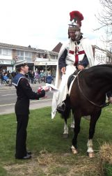 St.George hands the Flag of England to the leader of the Colour Party