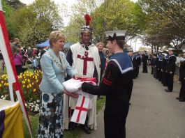 Mayor Cllr Susan Bayford receiving the flag of St.George